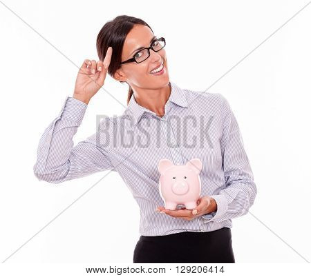 Smiling Businesswoman Holding Pink Piggy Bank
