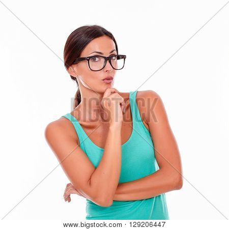 Planning Brunette Woman With Green Tank Top