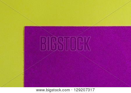 Eva foam ethylene vinyl acetate sponge plush pink surface on lemon yellow smooth background