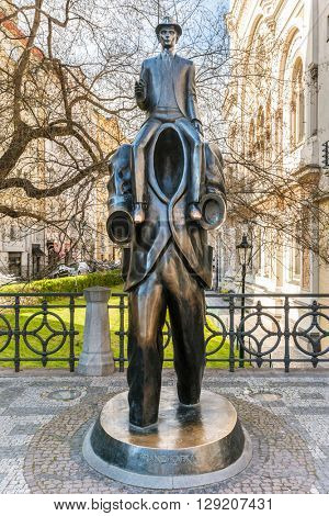 PRAGUE, CZECH REPUBLIC - APRIL 28, 2016: Jaroslav Rona's bronze statue of Franz Kafka in Prague, Czech Republic. The statue is inspired by Description of a Struggle, a short story by Kafka.