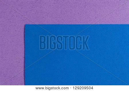 Eva foam ethylene vinyl acetate blue surface on light purple sponge plush background