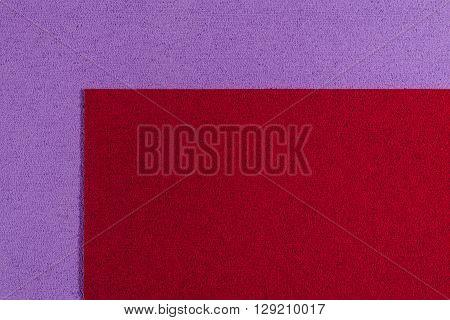 Eva foam ethylene vinyl acetate red surface on light purple sponge plush background