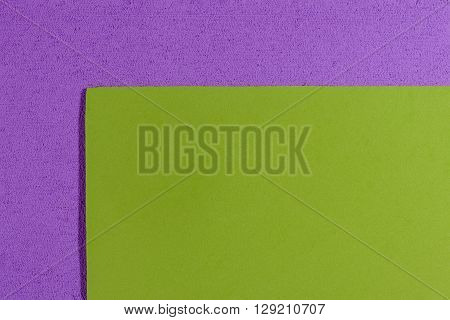 Eva foam ethylene vinyl acetate smooth apple green surface on light purple sponge plush background