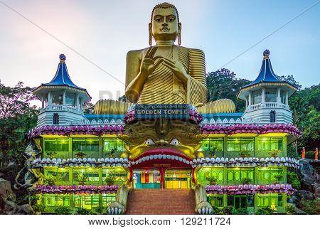 Danbulla Sri Lanka - December 5 2012: The large Buddah statue at the entrance of the Golden Temple