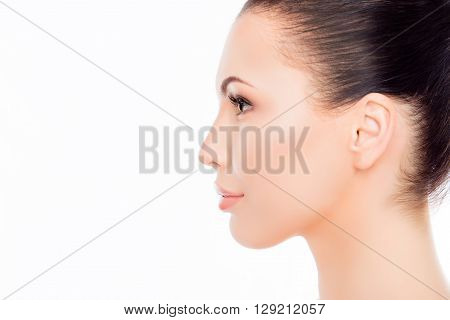 Side View Portrait Of Attractive Woman's Face On White Background