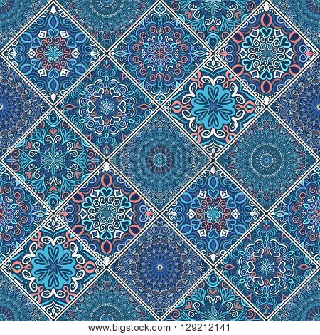 Rich blue tile ornament from mandalas. Seamless pattern in oriental style. Square tile patchwork design. Intricate tile pattern. Boho chic tile pattern for fashion fabric, furniture, wallpaper.