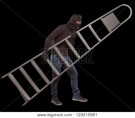 Masked thief slealing ladder from house. Swindler using ladder for burglary or robbery. Mafia concept. Isolated on black.