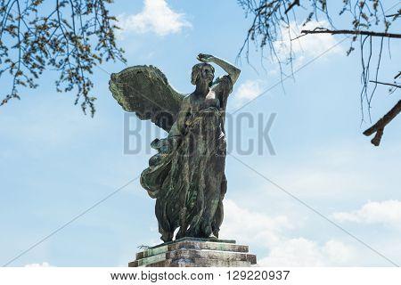 Empoli Italy - 07 May 2016: The bronze statue in Della Vittoria Square of the goddess Victory in realized by Dario Manetti and Carlo Rivalta in 1925. poster