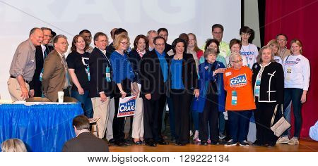 SHAKOPEE, MINNESOTA - APRIL 30, 2016: Congressional candidate Angie Craig (woman in front center in blue and black) with supporters after her endorsement at party convention in Shakopee on April 30.