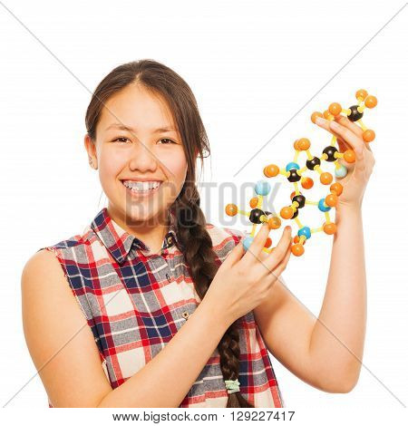 Smiling Asian teenage schoolgirl examining molecular structure, isolated on white background