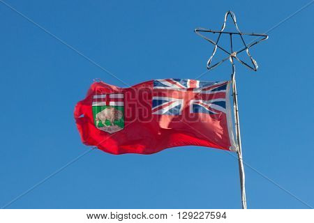 Manitoba provincial flag on flagpole with star top ** Note: Soft Focus at 100%, best at smaller sizes