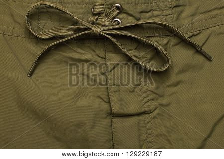 close fly green jeans texture background closeup