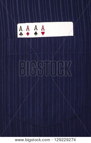 four ace cards inside front pocket blue male shirt closeup