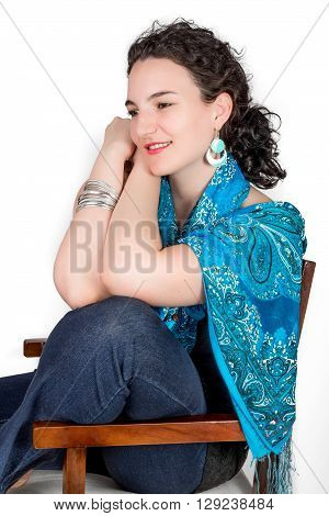 Young Model In Her Mid Twenties Wearing Aqua Colored Earrings Of Middle Eastern Design And A Blue Sh