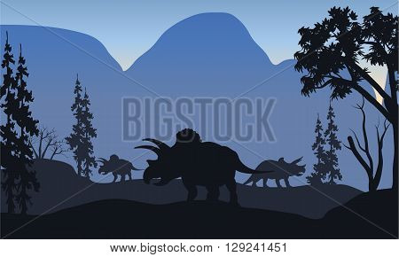 triceratops of silhouette in hills with blue backgrounds
