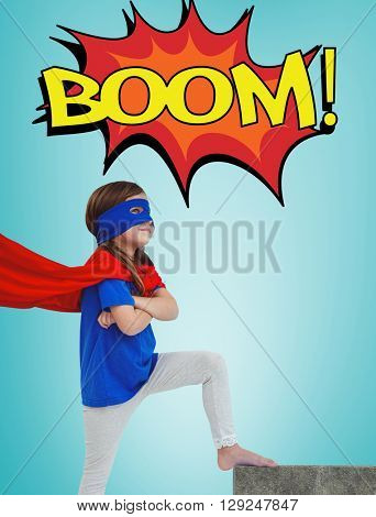 Girl dressed as superhero against blue vignette background