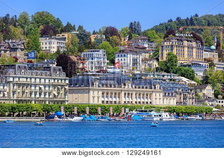 Lucerne, Switzerland - 8 May, 2016: view on the city over Lake Lucerne with the Grand Casino Lucerne and Hotel Montana buildings. Lucerne is a city in central Switzerland, it is the capital of the Swiss Canton of Lucerne.