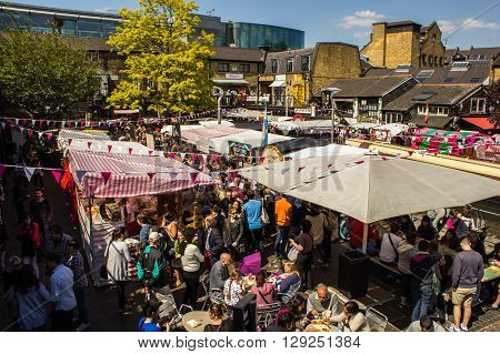 LONDON UK - 27TH MAY 2013: A view of food stalls at Camden Market during the day. Lots of people can be seen.