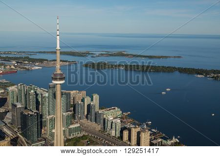 TORONTO CANADA - 6TH JUNE 2015: A view towards Lake Ontario from the Air showing some buildings in downtown Toronto The CN Tower and the Island Park.