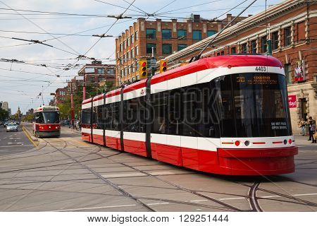 TORONTO CANADA - 9TH SEPTEMBER 2014: A view of the new Toronto Street Cars during the day. Passengers can be seen on the vehicle