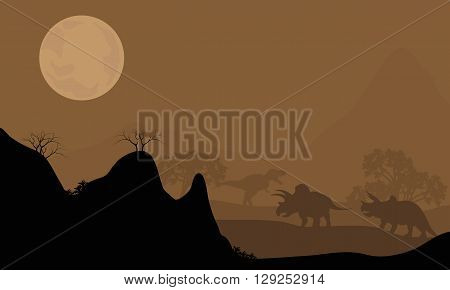 Silhouette of triceratops with moon at night with brown backgrounds