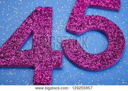 Number fortyfive purple color over a blue background. Anniversary. Horizontal