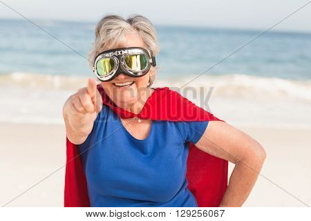 Senior woman wearing superwoman custome on a sunny day