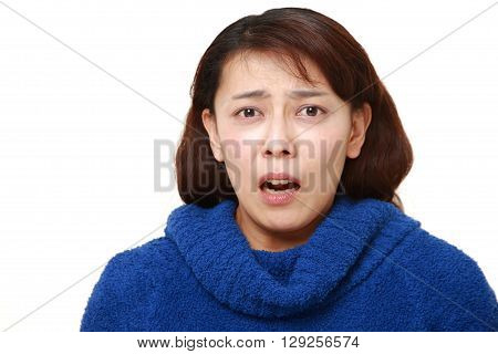 portrait of panicking woman on white background