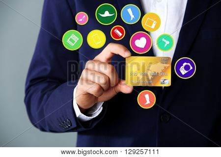 Online shopping. Businessman holding credit card,  close-up