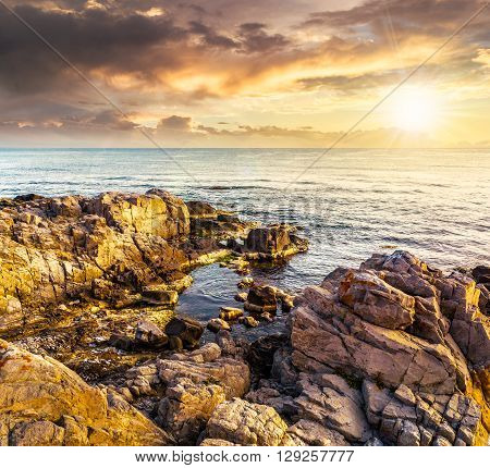 Sea Landscape On The Rocky Coast At Sunset
