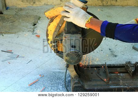 Electrical cutting machine during cutting steel on the building site