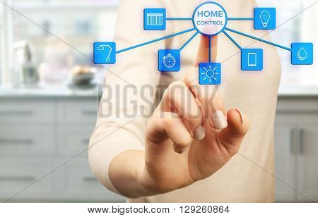 Using smart home app on virtual screen. Smart home control concept.