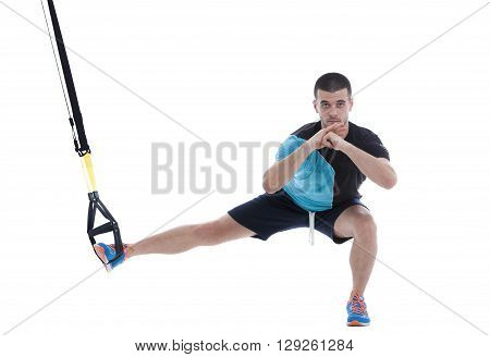 Athletic trainer on functional loops for training isolated on white background.