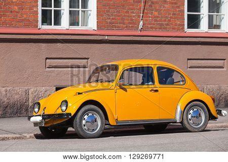 Old Yellow Volkswagen Beetle In The City
