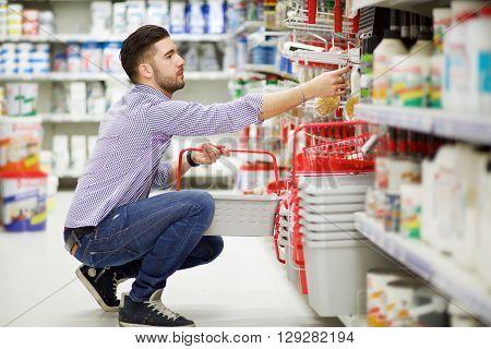 male caucasian customer buy in hardware store