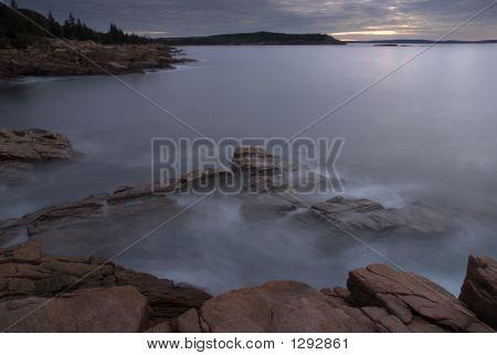 Surf Mist On Rocks At Dawn