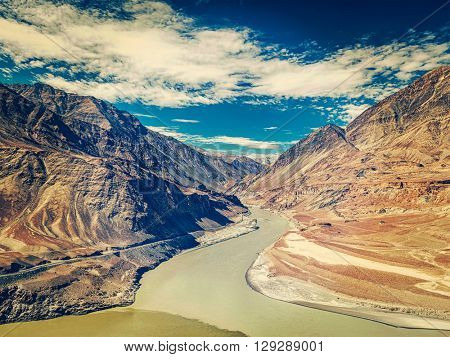 Vintage retro effect filtered hipster style image of confluence of Indus and Zanskar rivers in Himalayas. Indus valley, Ladakh, India