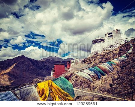 Vintage retro effect filtered hipster style image of Leh Tsemo fort and gompa and lungta (prayer flags) flying in the wind. Leh, Ladakh, Jammu and Kashmir, India