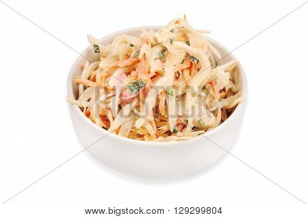 Side view of  bowl filled with coleslaw isolated on a white background.