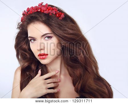 Beautiful Girl Model With Chaplet On The Head. Long Brown Wavy Hair. Makeup. Care. Woman Isolated On