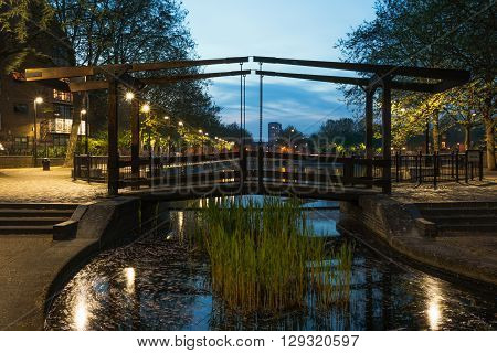 Wooden path bridge over London Albion Channel linking to Surrey Water