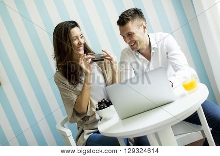 Couple At Home Shopping Online