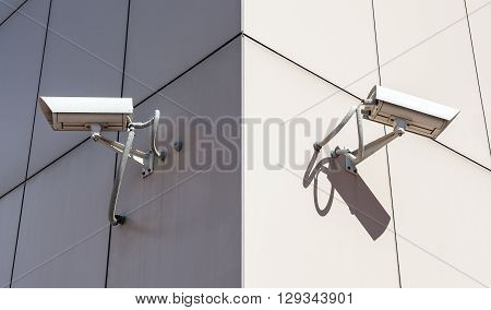 Surveillance cameras mounted on the corner of the building