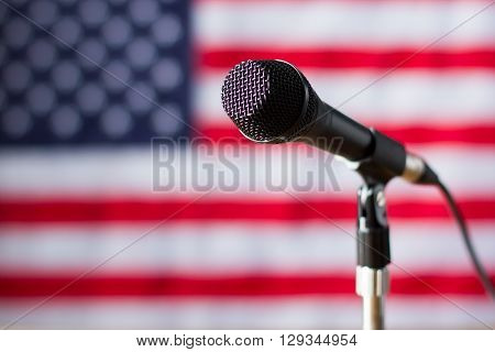 Microphone on US flag background. Banner and microphone with wire. Truth will soon be told. Broadcast for american citizens.