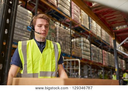 Man wearing a headset working in a distribution warehouse
