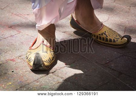 NEW YORK - APR 30 2016: Close up of a mans traditional khussa shoes at the Holi Hai Festival of Colors in Dag Hammerskjold Plaza hosted by NYC Bhangra in New York on April 30, 2016.