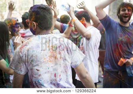 NEW YORK - APR 30 2016: People celebrating Holi Hai Festival of Colors with colorful powder on their faces in Dag Hammerskjold Plaza hosted by NYC Bhangra in New York on April 30, 2016.