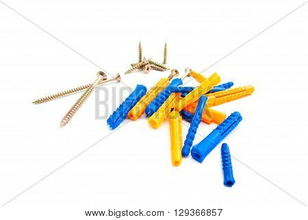 Colored Dowels And Screws On White