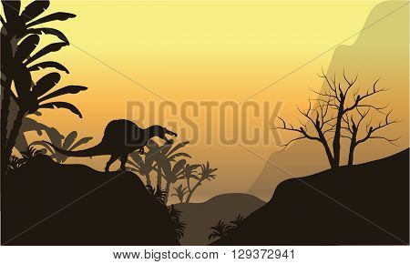 Silhouette of one spinosaurus in hills at the sunset