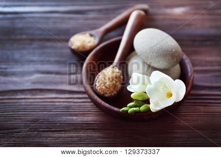 Spa composition with alight candles and beautiful flowers on wooden background